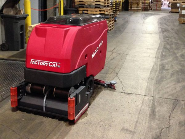 Factory Cat Magnum HD scrubber drier cleaning a concrete warehouse floor