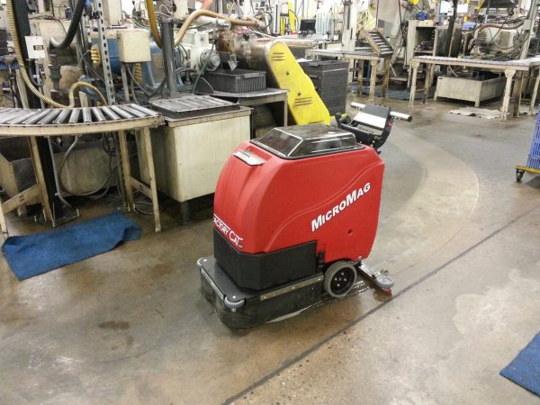 Factory Cat Micro-Mag Scrubber Dryer cleaning dirty production areas