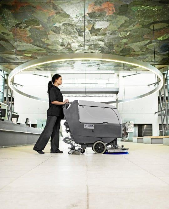 Nilfisk BA551 D disc scrubber dryer in an airport