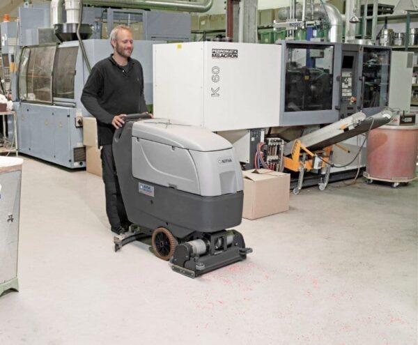 Nilfisk BA551 CD walk behin floor scrubber dryer for factory cleaning.