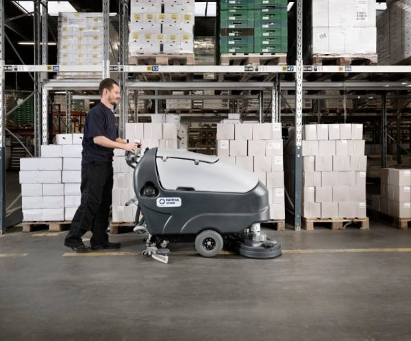 Nilfisk SC800 pedestrian scrubber drier for large warehouse cleaning