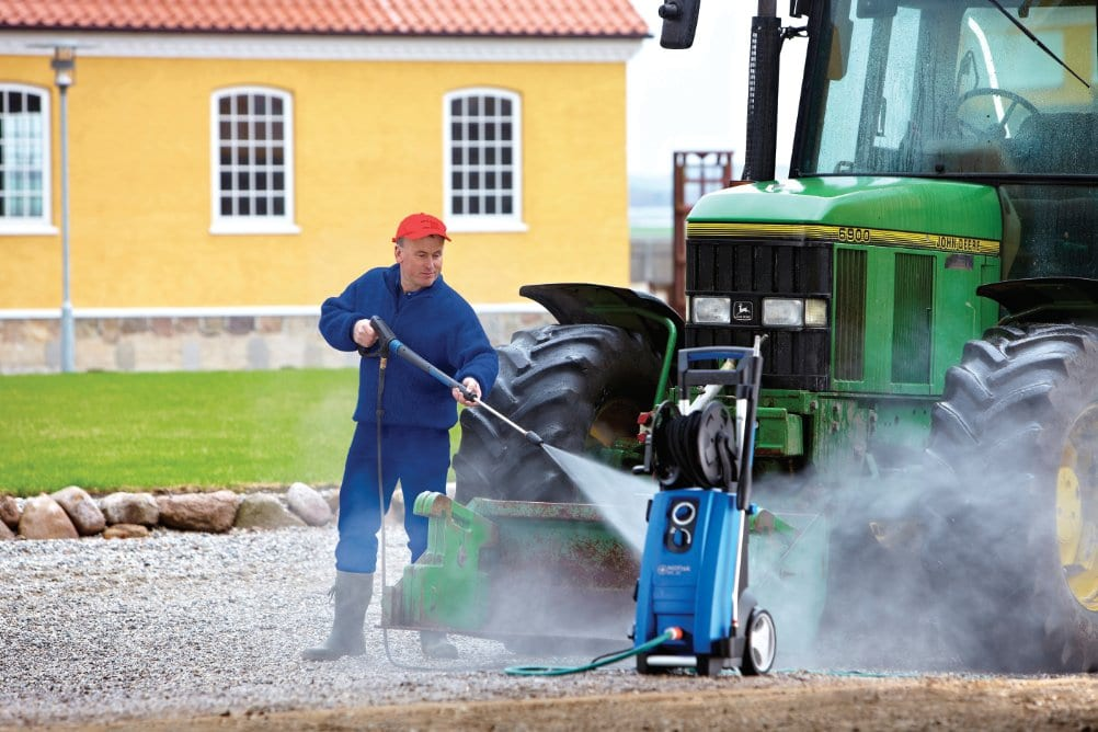 Using a mobile pressure washer on a tractor